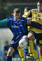 Fotball, La Manga, Spania. 20. februar 2002. Stabæk - Lillestrøm 1-0. Peter Sand, Stabæk, og Clayton Zane, Lillestrøm.
