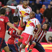 Thierry Henry, (top), New York Red Bulls, heads goal wards as teammate Jamison Olave challenges during the New York Red Bulls V Chivas USA, Major League Soccer regular season match at Red Bull Arena, Harrison, New Jersey. USA. 30th March 2014. Photo Tim Clayton