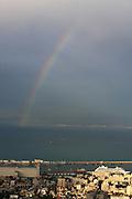 Israel, Haifa. View of Haifa port, Haifa bay and downtown. Rainbow over the bay ..