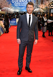 Glen Powell attending The Guernsey Literary and Potato Peel Pie Society world premiere held at Curzon Mayfair, London.