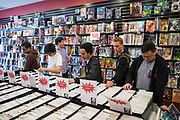 Patrons look at back issues of comic books during Free Comic Book Day at Black Cat Comics in Milpitas, California, on May 6, 2017. (Stan Olszewski/SOSKIphoto)