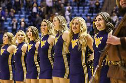 Dec 1, 2019; Morgantown, WV, USA; The West Virginia Mountaineers dance team celebrates after beating the Rhode Island Rams at WVU Coliseum. Mandatory Credit: Ben Queen-USA TODAY Sports