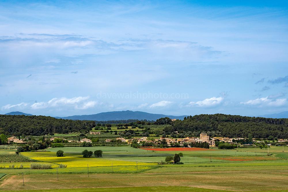 Sant Feliu de Boada, seen from the medieval town of Pals, in Baix Emporda, Catalonia, Spain.