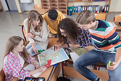University students searching in map in classroom, Bavaria, Germany