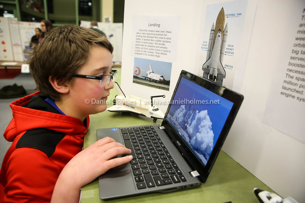 (2/15/17, MEDWAY, MA) Eighth-grader Josh Auler shows his project on space shuttles during the seventh and eighth grade science fair at Medway Middle School on Wednesday. [Daily News and Wicked Local Photo/Dan Holmes]