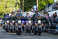 NH State Police lead the 23rd anniversary POW/MIA Freedom Ride down Lakeside Avenue Thursday evening.  (Karen Bobotas/for the Laconia Daily Sun)