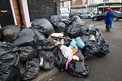 © Licensed to London News Pictures. 20/02/2019. Birmingham, UK. Birmingham bin men work to rule. Pictured, a large collection of rubbish in Gowan Street, Alum Rock. Industrial action by Birmingham waste collection services is resulting in a build up of rubbish on the streets in areas of the City. Photo credit: Dave Warren/LNP