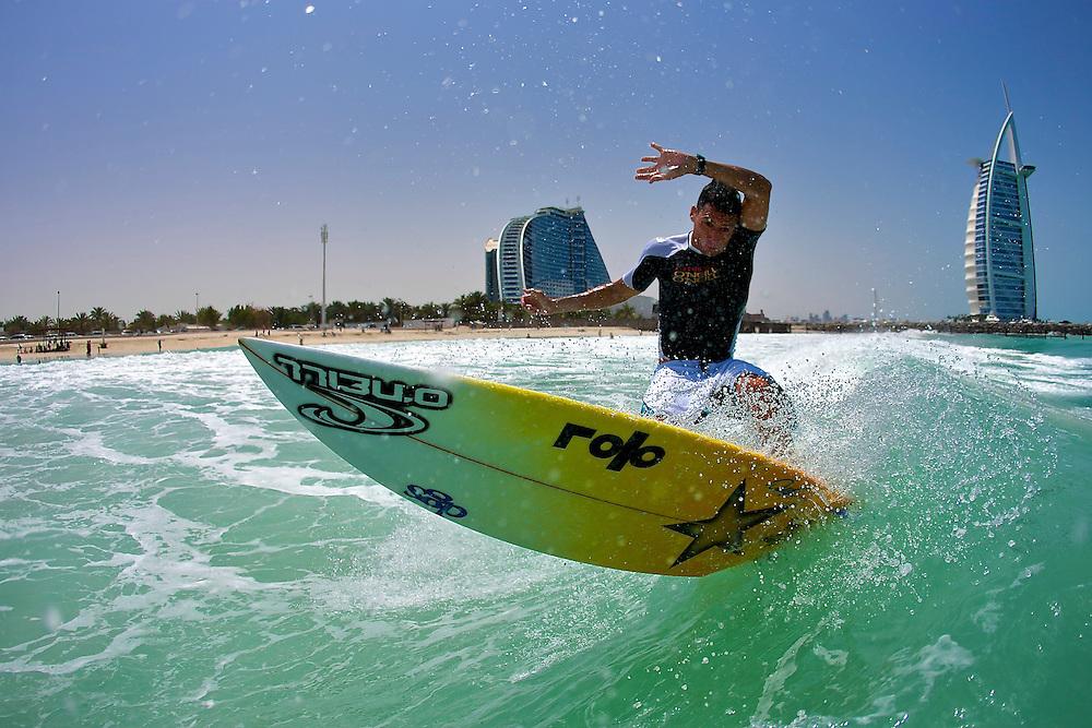 Graeme Fenton surfing in Dubai with the Burj Al Arab in the background