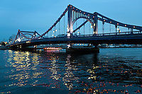 """The Kiyosu Bridge, built in 1928 after the model of the Deutz Suspension Bridge of Cologne, links Kiyosu with Nihonbashi.  The Sumida River or Sumida-gawa as it is known in Japanese, is a river which flowing through Tokyo. It branches from the Arakawa River and flows into Tokyo Bay. Its tributaries include the Kanda and Shakujii rivers. What is now known as the """"Sumida River"""" was previously the path of the Arakawa River, however towards the end of the Meiji period the rivers were diverted from the main flow of the Arakawa to prevent flooding."""
