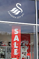 general view of Sale signs at the club shop at Swansea city FC in the week it has been announced that the club could be sold to American owners.  Liberty Stadium in Swansea, South Wales on Thursday 14th April 2016. the team are preparing for their next match against Newcastle Utd on Saturday. <br /> pic by Andrew Orchard, Andrew Orchard sports photography.