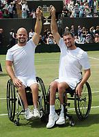 Tennis - 2019 Wimbledon Championships - Week Two, Saturday (Day Twelve)<br /> <br /> Men's Final of the Wheelchair doubles<br /> <br /> Alfie Hewett and Gordon Reid (GBR) v Joachim Gerard (BEL) v Stefan Olsson (SWE)<br /> <br /> Joachim Gerard v Stefan Olsson with the trophy on Court 3.<br /> <br /> COLORSPORT/ANDREW COWIE