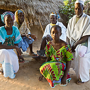 Koumbadiouma's inhabitants don their finest clothes on the morning of Tamkharit (Islamic New Year) and go out to meet and greet the rest of the village. Kolda, Senegal.