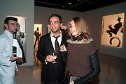 ANDY VALMORBIDA; CARINE ROITFELD, Richard Hambleton private view.- New York- Godfather of Street art presented by Vladimir Restoin Roitfeld and Andy Valmorbida in collaboration with Giorgio armani. The Old Dairy. London. 18 November 2010. -DO NOT ARCHIVE-© Copyright Photograph by Dafydd Jones. 248 Clapham Rd. London SW9 0PZ. Tel 0207 820 0771. www.dafjones.com.
