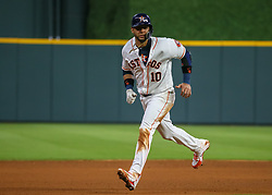 April 30, 2018 - Houston, TX, U.S. - HOUSTON, TX - APRIL 30:  Houston Astros first baseman Yuli Gurriel (10) takes off toward third base during the baseball game between the New York Yankees and Houston Astros on April 30, 2018 at Minute Maid Park in Houston, Texas.  (Photo by Leslie Plaza Johnson/Icon Sportswire) (Credit Image: © Leslie Plaza Johnson/Icon SMI via ZUMA Press)
