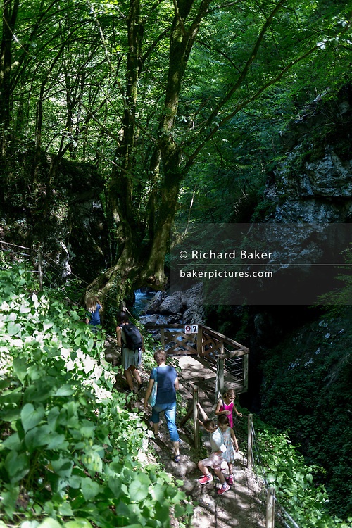 A family climb up from a viewing platform in Tolmin Gorge (Tolminska Korita), on 20th June 2018, in Tolmin Gorge , Slovenia.