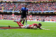 Alex Cuthbert of Wales scores the opening try.  RBS Six nations championship 2012, Wales v France at the Millennium Stadium in Cardiff, South Wales on Saturday 17th March 2012.  pic by Andrew Orchard, Andrew Orchard sports photography,