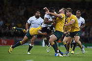 Australia's James Slipper ® is knocked out by the Arm of Peceli Yato of Fiji as he surges forward. Rugby World Cup 2015 pool A match, Australia v Fiji at the Millennium Stadium in Cardiff, South Wales  on Wednesday 23rd September 2015.<br /> pic by  Andrew Orchard, Andrew Orchard sports photography.