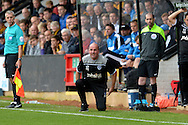 Paul Cook, the Portsmouth manager down on one knee shouting at this players from the touchline. Skybet football league two match, Cambridge Utd v Portsmouth at the Abbey Stadium  in Cambridge on Saturday 10th October 2015.<br /> pic by John Patrick Fletcher, Andrew Orchard sports photography.