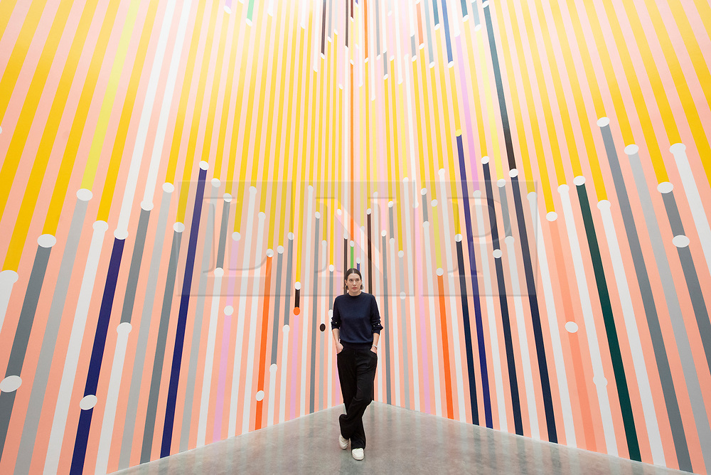 © Licensed to London News Pictures. 16/04/2019. London, UK. Artist Sarah Morris with her work titled 'What can be explained can also be predicted' (2019) showing as part of her exhibition  'Machines do not make us into Machines' exhibition at the White Cube gallery/ Photo credit: Ray Tang/LNP