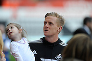 Swansea City Manager Garry Monk taking a walk around the pitch along with staff and player at full time as way of thanks to the loyal fans.<br /> Barclays Premier league match, Swansea city v Southampton at the Liberty stadium in Swansea, South Wales on Saturday 3rd May 2014.<br /> pic by Phil Rees, Andrew Orchard sports photography.