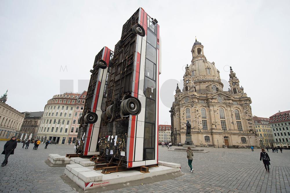 """11 MAR 2017, DRESDEN/GERMANY:<br /> Temporaere Skulptur """"Monument"""" von Manaf Halbouni, bestehend aus zwei Bussen, die vertikal aufgestellt sind vor der Frauenkriche, Neumarkt<br /> KEYWORDS: Omnibus, Bus"""