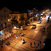 An overhead view of a street in downtown Vientiane, Laos, at night.