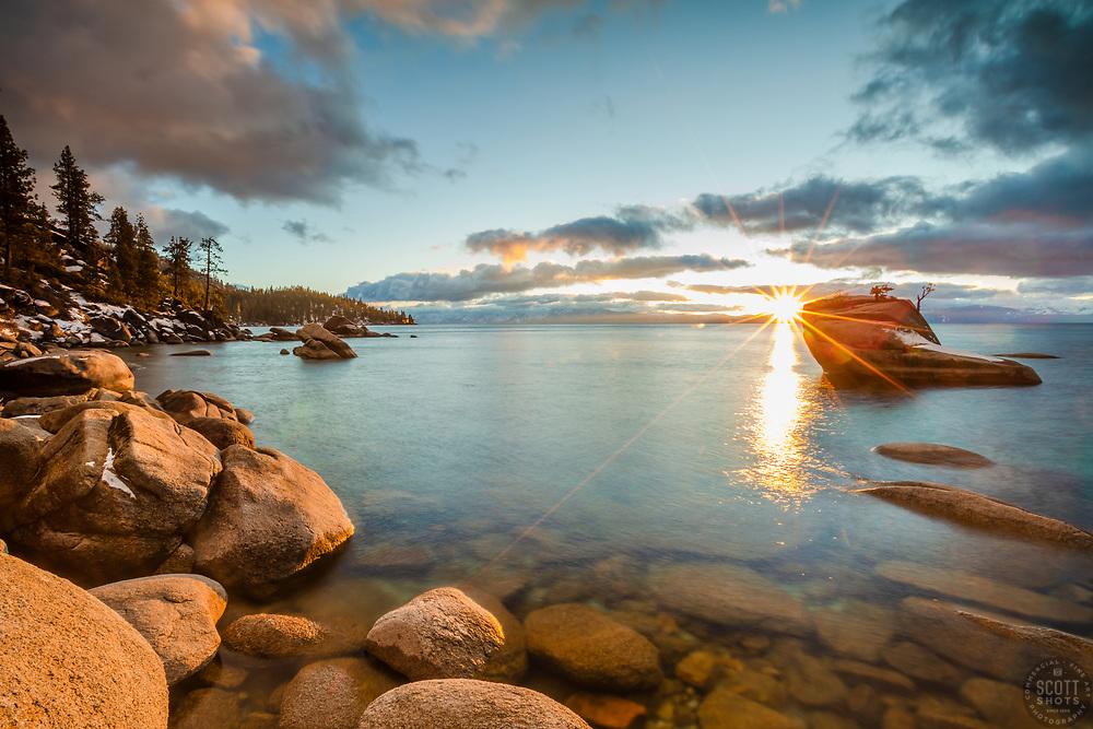 """Bonsai Rock Sunset 11"" - Photograph of a sunburst from the setting sun at Bonsai Rock on the east shore of Lake Tahoe."