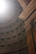 Sun flare from the oculus illuminates the dome interior of the Pantheon, Rome, Italy.