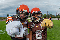 KELOWNA, BC - AUGUST 17:  Tyler GOING #20 and Kian ISHANI #8 of Okanagan Sun pose for a photo at the sidelines during warm up against the Westshore Rebels  at the Apple Bowl on August 17, 2019 in Kelowna, Canada. (Photo by Marissa Baecker/Shoot the Breeze)
