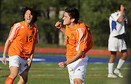 Middletown, New York  - Hicksville High School soccer players, at left, celebrate their 1-0 victory over Webster Schroeder in the New York State Class AA  boys' soccer championship game on Nov. 20, 2011.