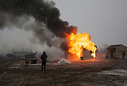 Structures at the Oceti Sakowin camp near the Standing Rock Sioux Reservation are burned by protesters before the deadline to vacate the camp that afternoon.