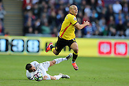 Nordin Amrabat of Watford breaks away from the tackle from Leon Britton of Swansea city (l).  Premier league match, Swansea city v Watford at the Liberty Stadium in Swansea, South Wales on Saturday 22nd October 2016.<br /> pic by  Andrew Orchard, Andrew Orchard sports photography.