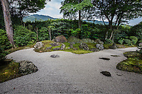 "Nirvana Shakkei Garden at Shinnyodo -  Three gardens are to be found at <br /> Shinnyodo Temple.  The first is the Nehan ""Nirvana"" garden and was built in the classic karesansui rock garden style in 1988. It uses the shakkei borrowed landscape technique to include Mt. Hiei in its design. The second garden was designed by Shigemori Chisao - Its modern geometrical style is similar in design to his father renowned landscape architect and garden designer Shigemori Mirei. The third is a small tea garden, with its own tea ceremony hut."