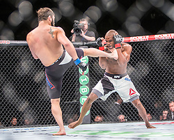 Jimmie Rivera of the United States (beard) fights Marcus Brimage of the United States in their bantamweight fight during the UFC Fight Night Glasgow event on Saturday, July 18 at The SSE Hydro. The UFC Fight Night 72 event was the first the promotion had been hosted in Scotland.