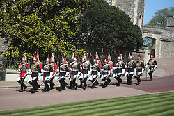 A dismounted detachment of The Life Guards and The Blues & Royals of The Household Cavalry arrive at Windsor Castle, Berkshire, ahead of the funeral of the Duke of Edinburgh. Picture date: Saturday April 17, 2021.