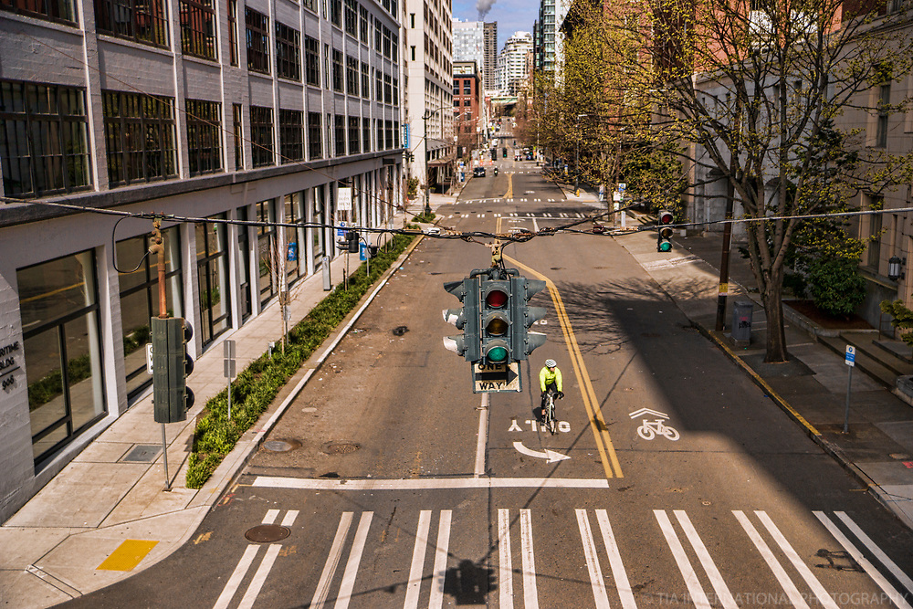 Western Avenue appears to belong to the sole cyclist riding through the hollow chasms of the downtown neighborhood. (April 4, 2020).