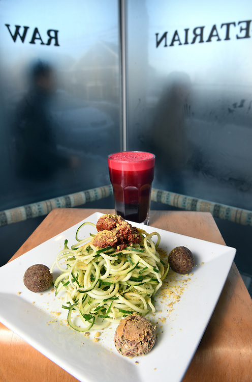 """Mara Lavitt /For Hearst Connecticut Media<br /> February 6, 2016<br /> Catch A Healthy Habit Cafe, Fairfield. Zucchini spaghetti with tomato sauce, basil oil, Rawmesan (a commercial product of walnuts, sunflower seeds, nutritional yeast and salt) and """"meatballs"""" (meatballs are made of walnuts and herbs) with the juice drink called Blood made of beets, red apple, lemon and ginger."""