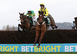 Lostintranslation ridden by Robbie Power (left) jumps with Defi Du Seuil ridden by Barry Geraghty in the Betbright Dipper Novices' Chase during the New Year Meeting at Cheltenham Racecourse.