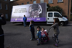 """© London News Pictures. """"Looking for Nigel"""". A body of work by photographer Mary Turner, studying UKIP leader Nigel Farage and his followers throughout the 2015 election campaign. PICTURE SHOWS - A family has their photographs taken in front of a UKIP billboard inveiled at Himley Hall, Dudley on April 7th 2015 as Nigel Farage and his team toured the Midlands mid-campaign. . Photo credit: Mary Turner/LNP **PLEASE CALL TO ARRANGE FEE** **More images available on request**"""
