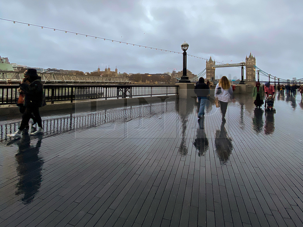 © Licensed to London News Pictures. 13/12/2020. London, UK. Reflection of people on a wet surface caused by rainfall in the capital. Photo credit: Dinendra Haria/LNP