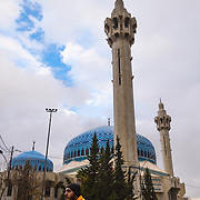 The King Abdullah I Mosque in Amman, Jordan was built between 1982 and 1989. It is capped by a magnificent blue mosaic dome beneath which 3,000 Muslims may offer prayer.