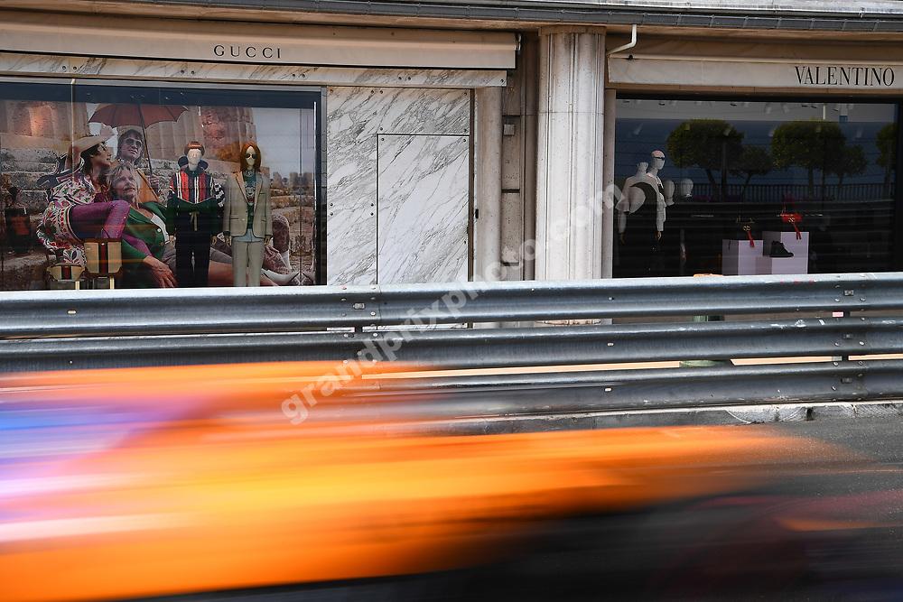 McLaren-Renault passes luxury shops during practice before the 2019 Monaco Grand Prix. Photo: Grand Prix Photo