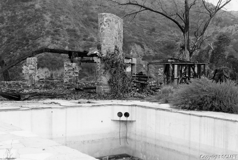 """1973 Burned out ruins of a home in the """"The Pines"""". Occupied by Errol Flynn in 1958 when he appeared at the Huntington Hartford Theater"""
