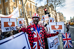 © Licensed to London News Pictures. 14/02/2019. London, UK. A pro-Brexit demonstrator wears a love heart suit for Valentine's Day during a protest opposite Downing Street. MPs continue to debate Brexit in Parliament, and will vote on a series of amendments today. Photo credit: Rob Pinney/LNP