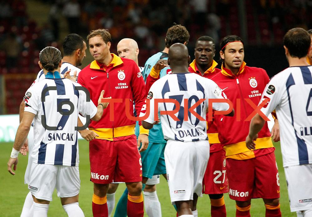 Galatasaray's Johan Elmander and Kasimpasa's during their Turkish Super League soccer match Galatasaray between Kasimpasa at the TT Arena at Seyrantepe in Istanbul Turkey on Monday 20 August 2012. Photo by TURKPIX