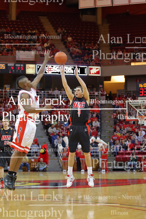 20 December 2008: Robo Kreps takes a long shot as Osiris Eldridge leaps and reaches for a block during a game where the  Illinois State University Redbirds go to 11-0 on the season defeating the Flames of Illinois Chicago by a score of 67-60 on Doug Collins Court inside Redbird Arena on the campus of Illinois State University in Normal Illinois.