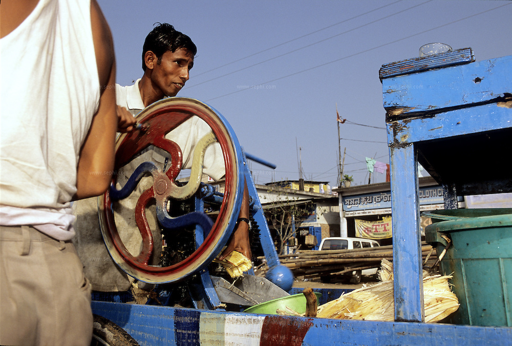 Ganna (Shugar cane) juice vendor, Assam, India