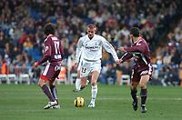 22/12/2004 - La Liga - Real Madrid v Sevilla<br />Real Madrid's David Beckham cuts between two Sevilla defenders<br />Photo: Back Page Images