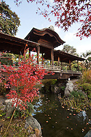 """Kaito-ro, a covered bridge connects the north edge of Engetsu-chi pond and the north island at Shosei-en Garden - designed as a retreat for the chief priest Sen'nyo.  Shosei-en is also called Kikoku-tei """"Orange Mansion"""" because it was once surrounded by orange groves. The garden is a Chisen-Kaiyu-Shiki teien that is a pond garden, or strolling garden with buildings such as tea-ceremony houses and bridges  throughout the grounds."""