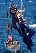 Australian flag being flown in boat by Sydney Harbour for Australia's Bicentenary, 1988